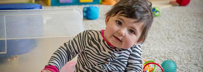 Infant child enjoying some indoor playtime.