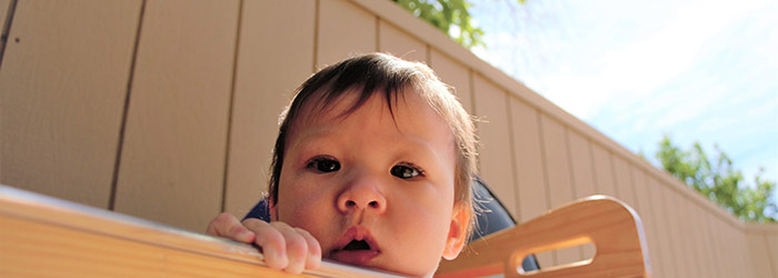 Infant enjoying some outdoor playtime in our daycare program.