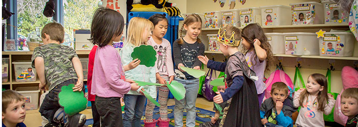 Children in our Pre-K childcare program playing in a group.