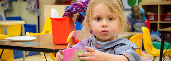 Preschoolers learn all sorts of new skills, such as painting.