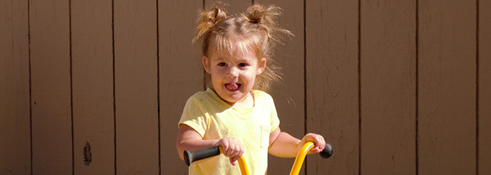 A yellow trike offers an adorable older toddler with new found independence.