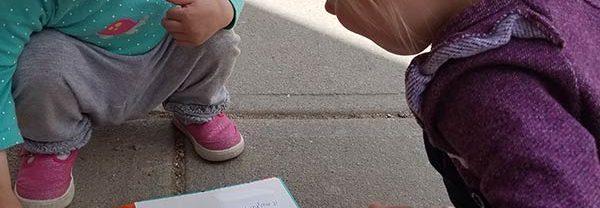 children reading their sensory book