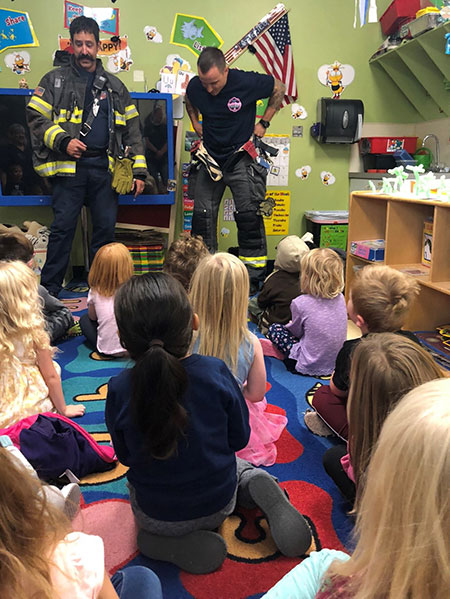 Firefighters teach our kids about their gear at our daycare.