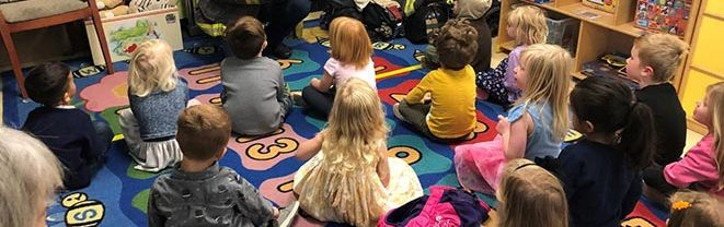 Firefighters teach our students about fire safety in our childcare classroom.