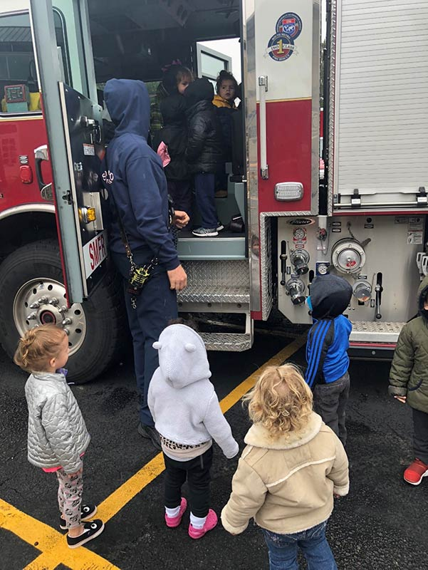 Our toddlers play in the firetruck