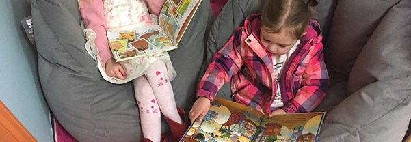Children reading at our daycare