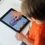 child playing on an ipad