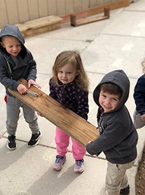 children playing woodshop at daycare