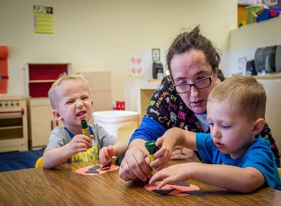 teacher with toddlers at child care center