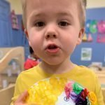 featured image boy with animal art at daycare
